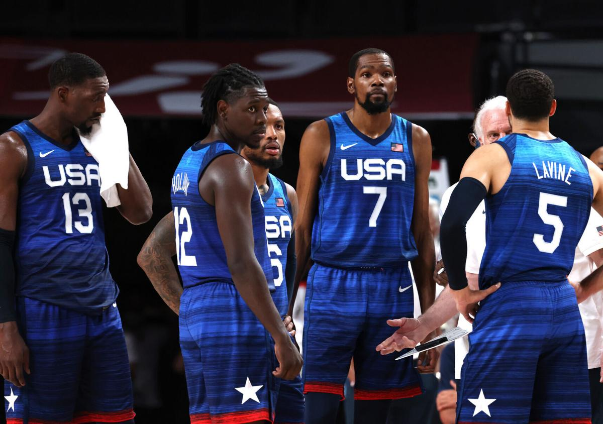 U.S. players, from left, Bam Adebayo, Jrue Holiday, Damian Lillard, Kevin Durant and Zach LaVine stand on the court during a timeout against France on Sunday, July 25, 2021 at the Tokyo Olympics at Saitama Super Arena in Tokyo, Japan.