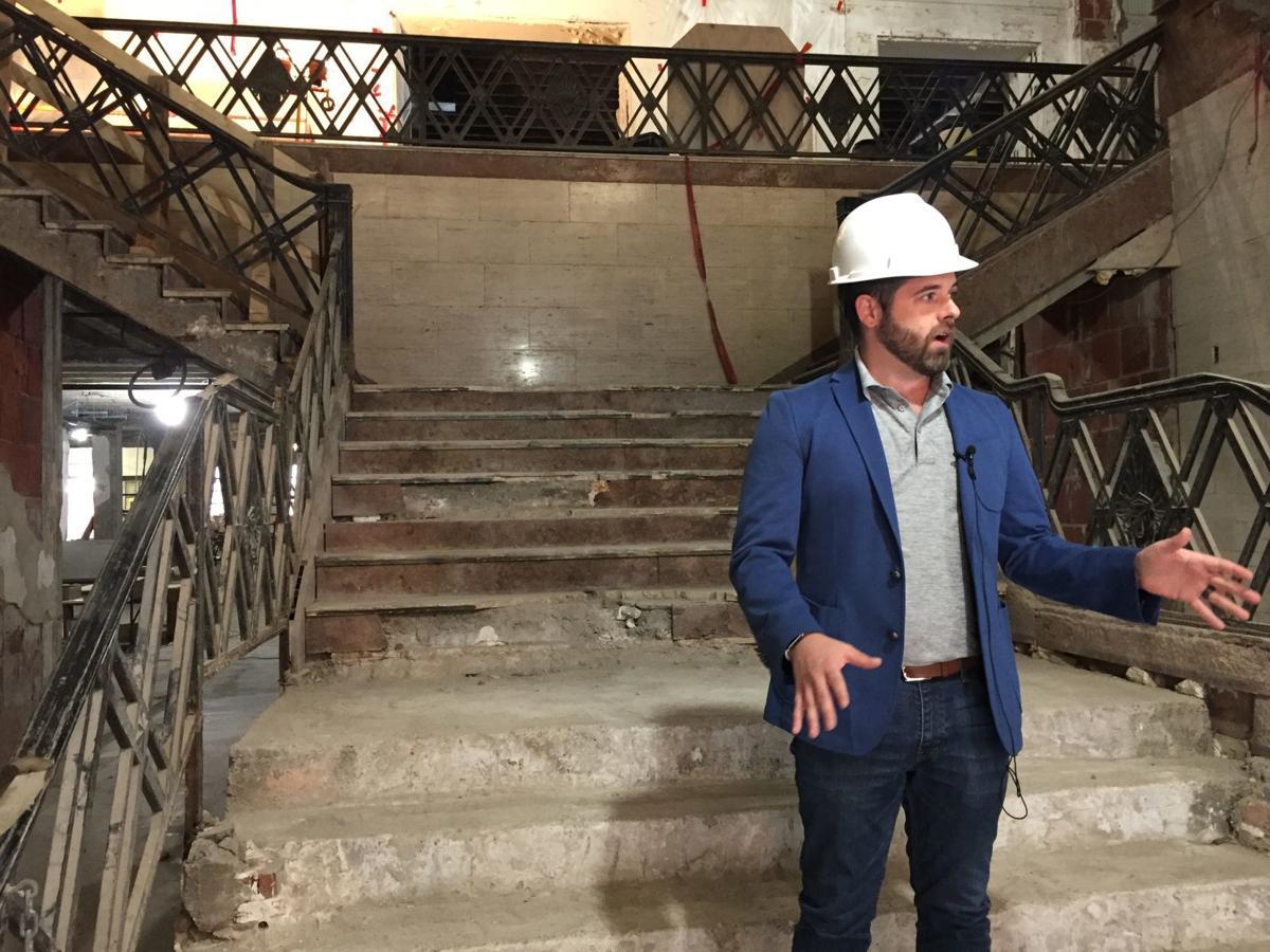 Alex Cherubin stands on the main stairs of the Warrior Hotel