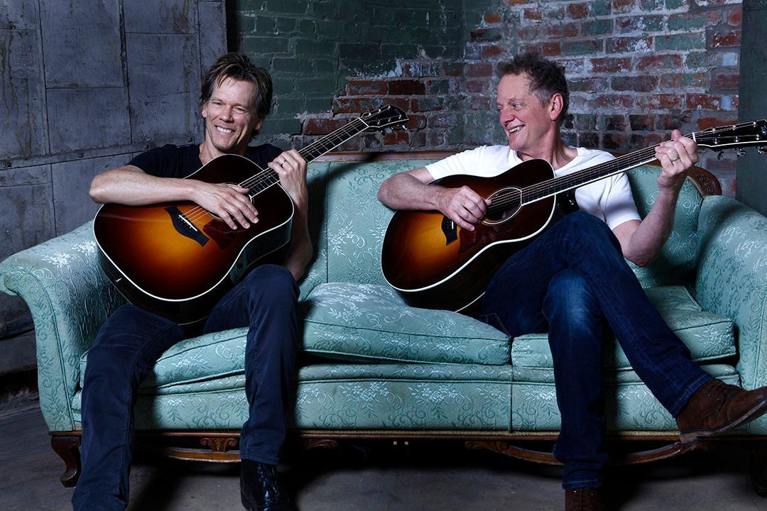 Bacon Brothers on a couch