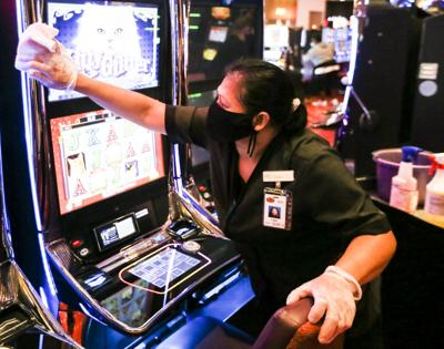 worker at casino in mask