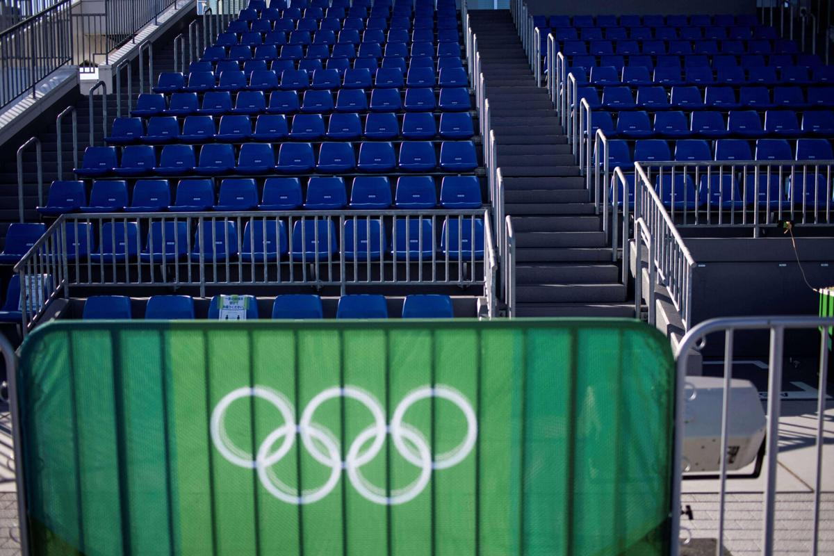 This picture shows the Olympic Rings and empty seats at the Sea Forest Waterway rowing venue ahead of the 2020 Olympic Games in Tokyo on July 18, 2021.