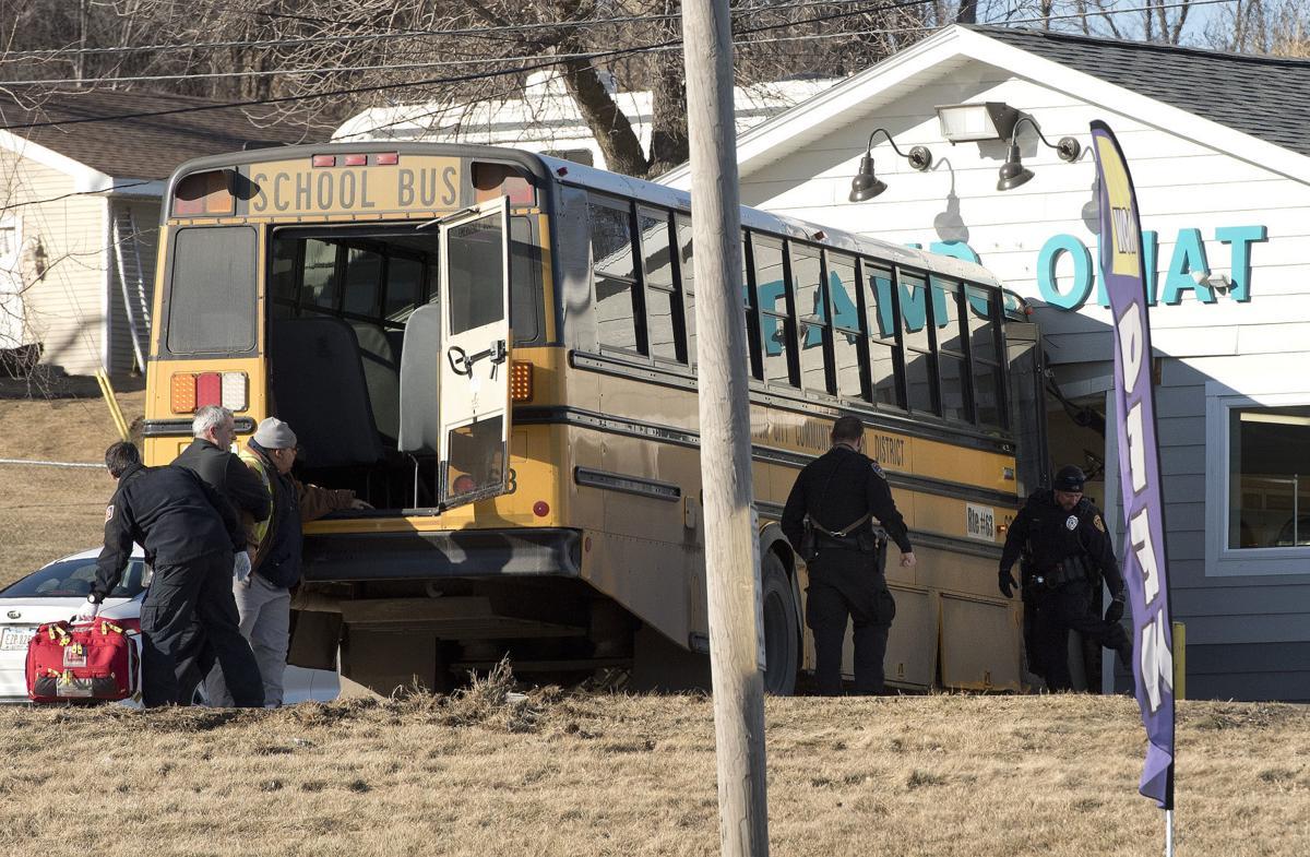 School bus vs laundromat accident