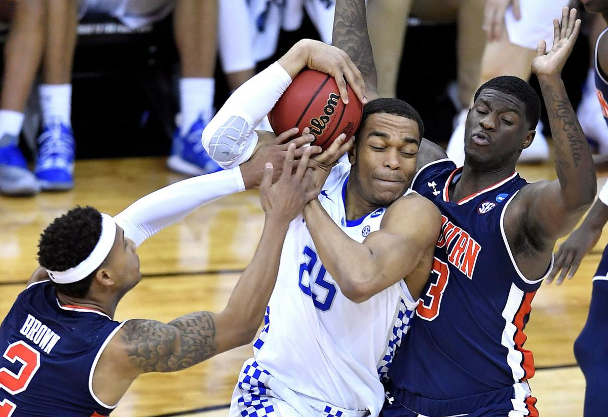 Kentucky's PJ Washington tries to drive between Auburn's Bryce Brown, left, and Danjel Purifoy during the second half of the NCAA Midwest Regional Final on Sunday, March 31, 2019 at the Sprint Center in Kansas City, Mo. Auburn beat Kentucky, 77-71, in overtime.