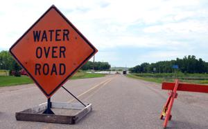 Woodbury County urges drivers not to ignore barricades; some roads damaged by flooding