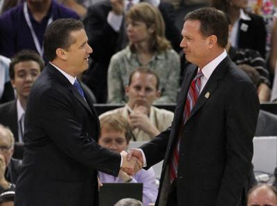 Head coach John Calipari, left, of Kentucky shakes hands with Kansas head coach Bill Self prior to the start of the NCAA Tournament finals at the Mercedes-Benz Superdome on April 2, 2012, in New Orleans.