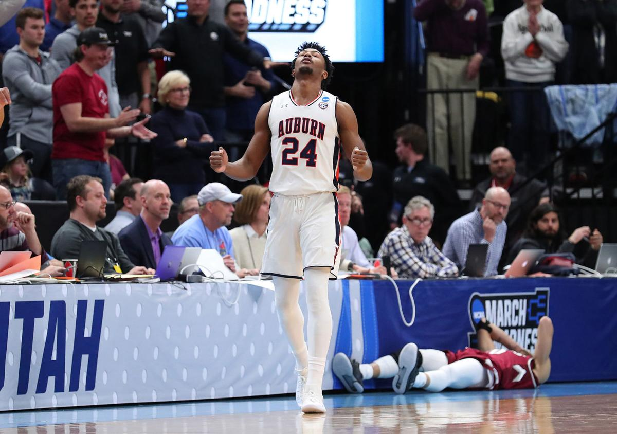 Anfernee McLemore (24) of the Auburn Tiger, celebrates after defeating the New Mexico State Aggies 78-77 in the first round of the 2019 NCAA Men's Basketball Tournament at Vivint Smart Home Arena on March 21, 2019 in Salt Lake City, Utah. (Tom Pennington/Getty Images/TNS)   **FOR USE WITH THIS STORY ONLY**