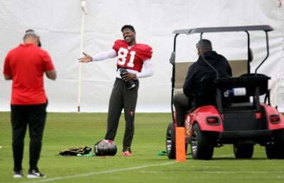 Bucs wide receiver Antonio Brown talks with staff as coach Bruce Arians arrives for a chat during a November practice at AdventHealth Training Center in Tampa.