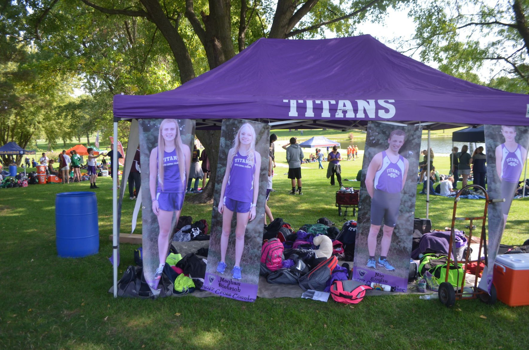 The cross country c&site for the South Central Calhoun Titans boats of a tent and life-size fabric posters of the student-athletes. & Cross country campsites move with the times | Siouxland Life ...