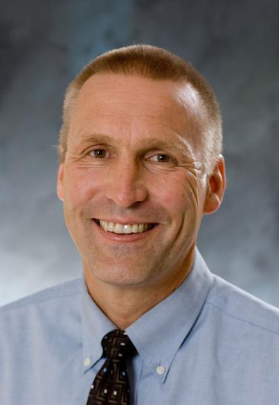 Dr. Earl Woudstra