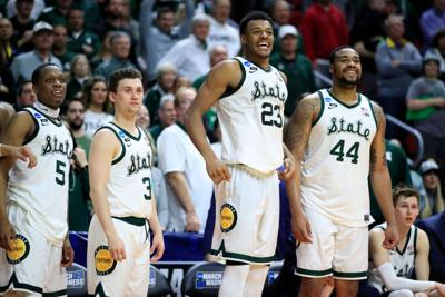DES MOINES, IOWA - MARCH 23: Cassius Winston (5), Foster Loyer (3), Xavier Tillman (23) and Nick Ward (44) of the Michigan State Spartans celebrate from the bench against the Minnesota Golden Gophers during the second half in a second round game of the 2019 NCAA Men's Basketball Tournament on March 23, 2019 at Wells Fargo Arena in Des Moines, Iowa. (Andy Lyons/Getty Images/TNS)   *FOR USE WITH THIS STORY ONLY*