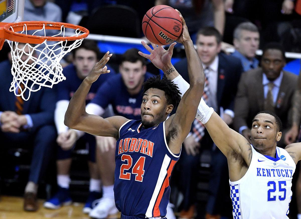 Auburn's Anfernee McLemore sails past Kentucky's PJ Washington for a shot during the second half of the NCAA Midwest Regional Final on Sunday, March 31, 2019 at the Sprint Center in Kansas City, Mo. Auburn beat Kentucky, 77-71, in overtime.