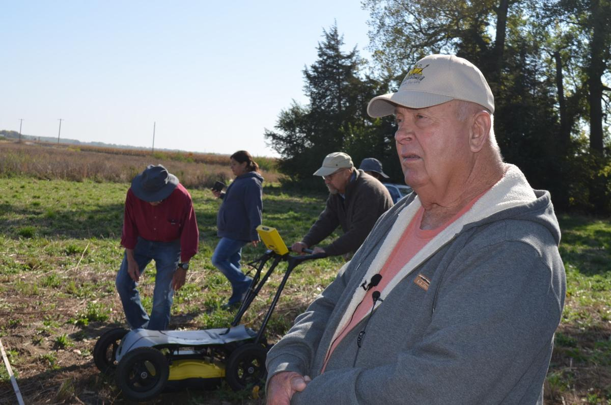 dennis reinert with archaeologists in the background