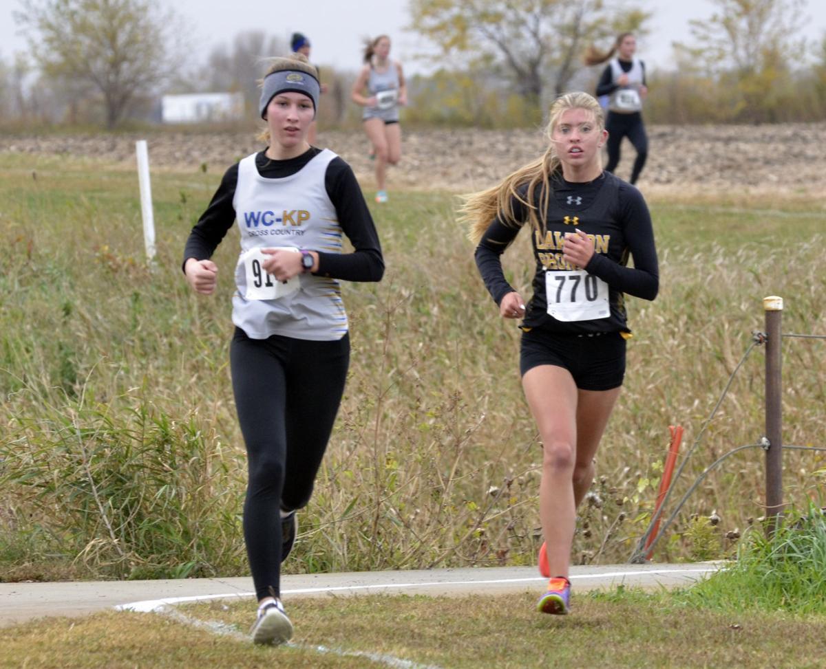 Erika Kuntz and Jolee Mesz run at WVC meet