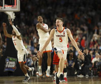 Virginia's Kyle Guy (5) celebrates along with teammates Braxton Key (2) and De'Andre Hunter (12) as the buzzer sounds on Virginia's win during the NCAA Tournament championship on April 8, 2019, at U.S. Bank Stadium in Minneapolis.