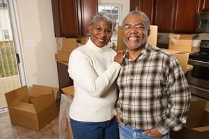 Mature Couple unpacking new home.jpg