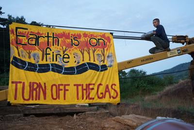 """EARTH IS ON FIRE, TURN OFF THE GAS""  banner"