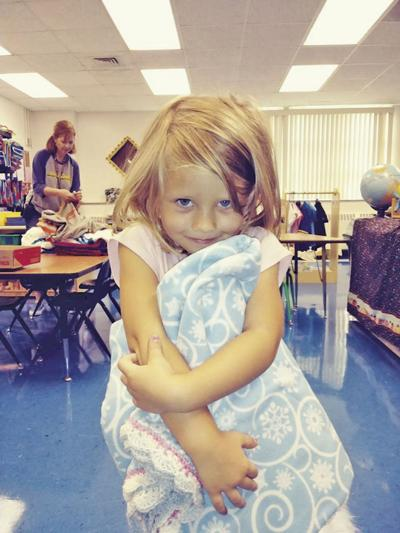 Sister's Circle donates blankets to schools