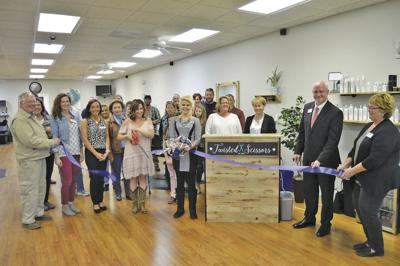 Twisted Scissors holds ribbon cutting