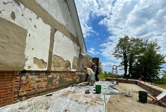 Volunteers help preserve 18th century artifact at Webster's Field