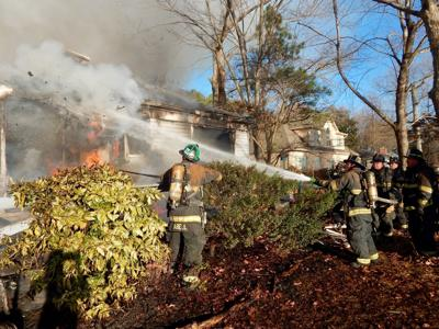 Firefighters douse flames last December at a home along the Potomac River.