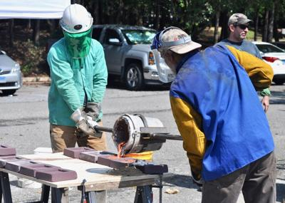 Students learn cultural collaboration through iron casting