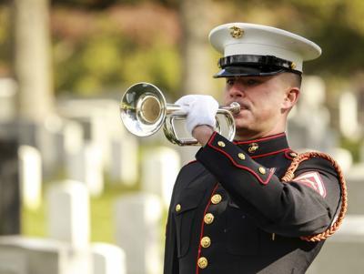 Marine Trumpeter playing taps