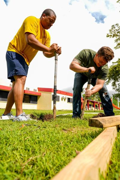 Waldorf sailor helps build swing set in Guam