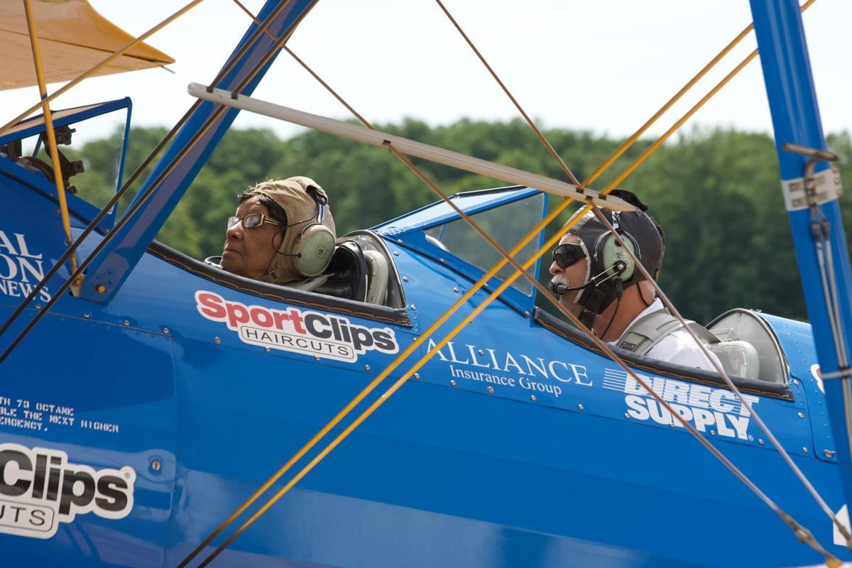 World War II veteran gets ride in vintage biplane