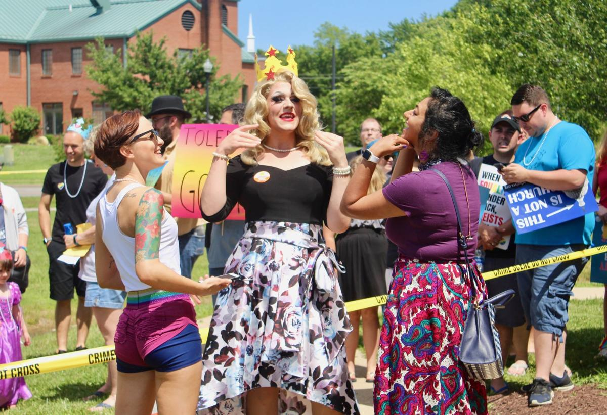 Supporters of drag queen story event gather outside Lexington Park library