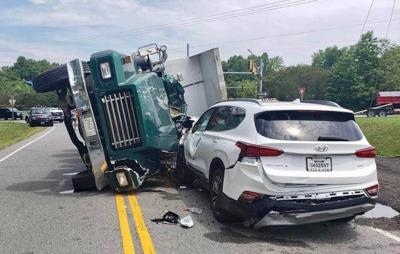 Four vehicles involved in dump truck incident