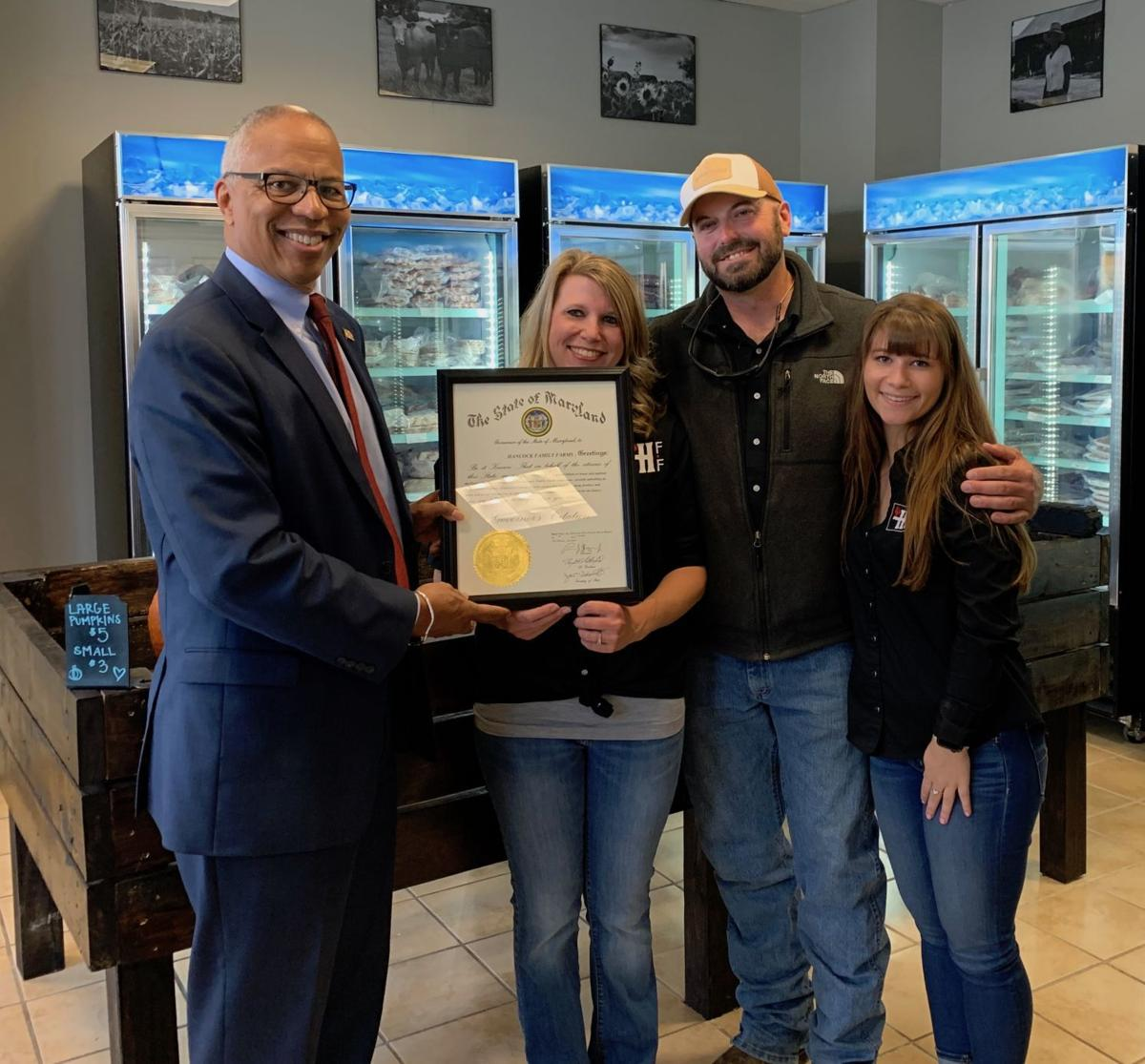 Lt. Gov. Boyd Rutherford presents award citations to La Plata businesses