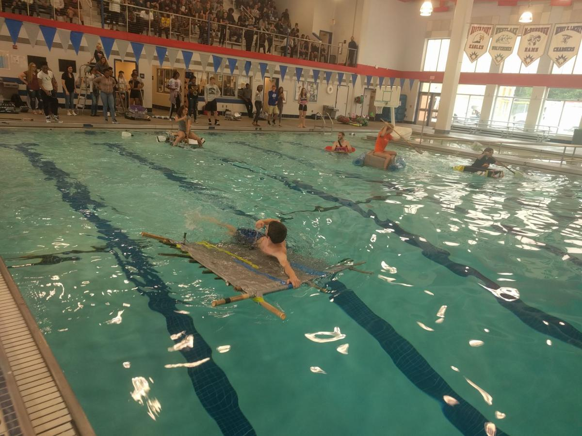 Henry lackey teams work to stay afloat in recycled boat - Is there sales tax on swimming pools ...