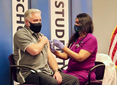 Scott Smith receives COVID-19 vaccine