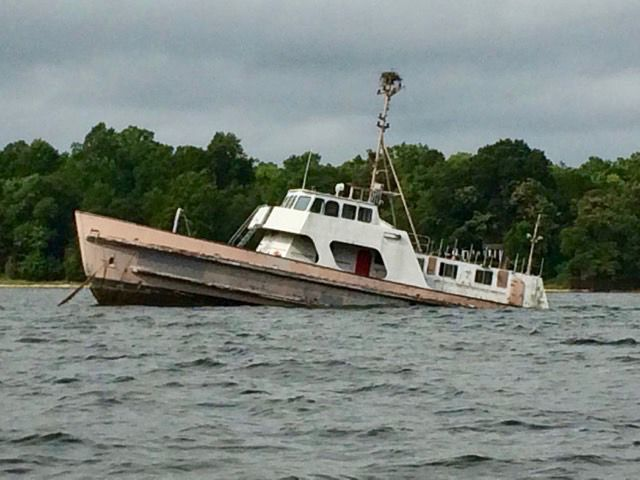 Abandoned boat sinks in Patuxent River near residential area