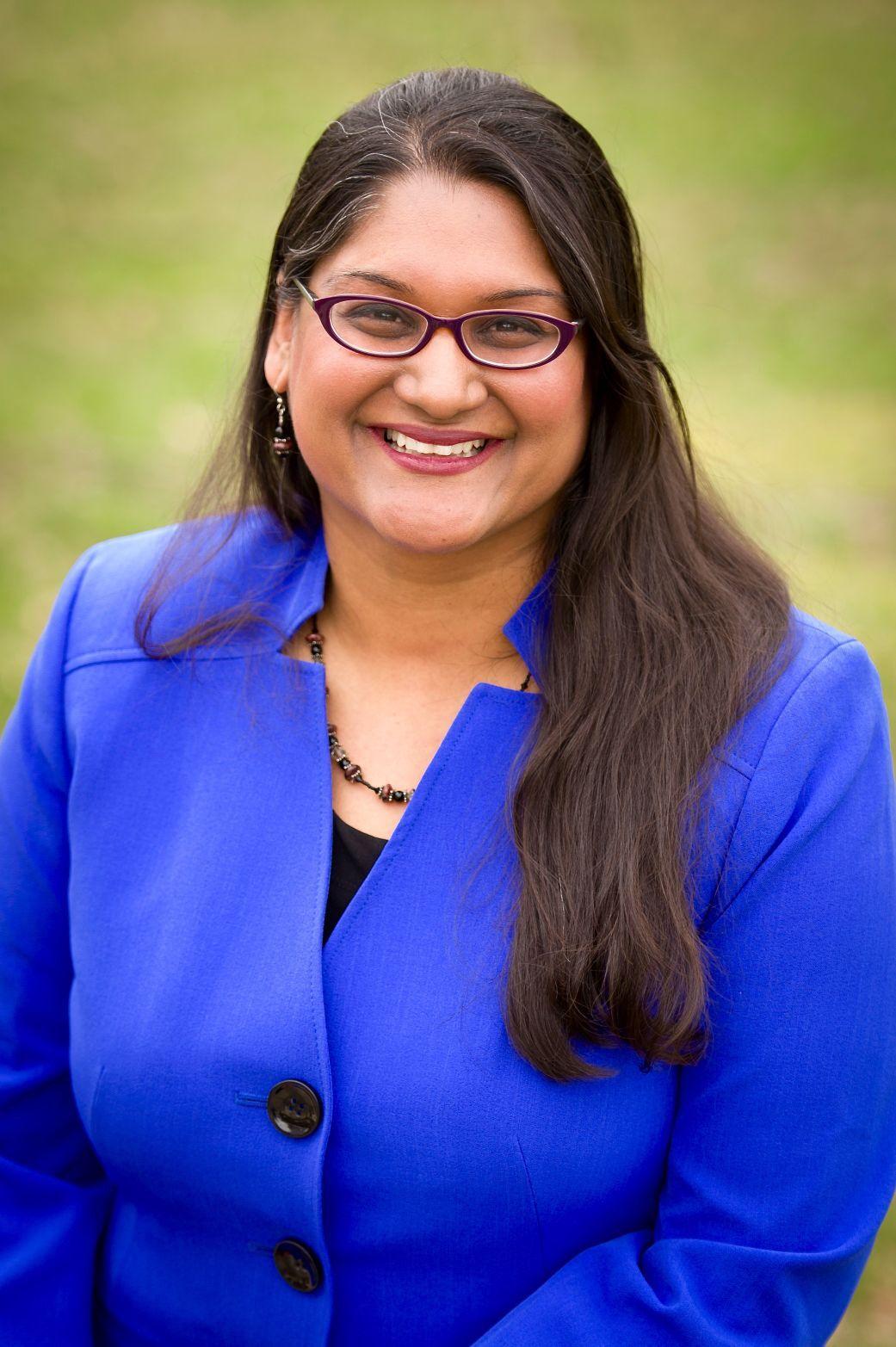 Dr. Meena Brewster