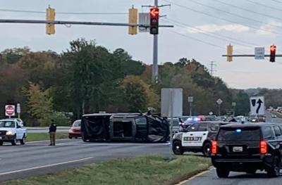 Flipped vehicle blocks morning traffic