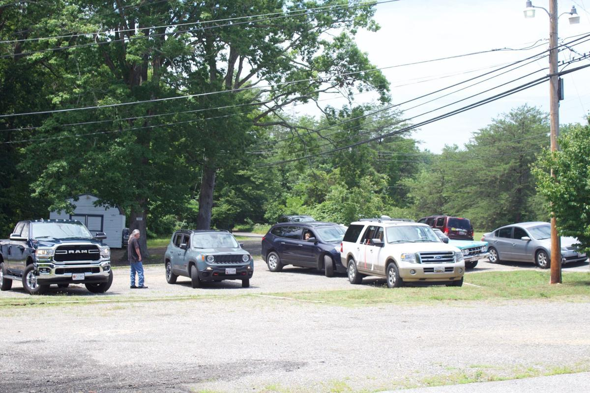 Cars lined up for a parade for Joy Sheff
