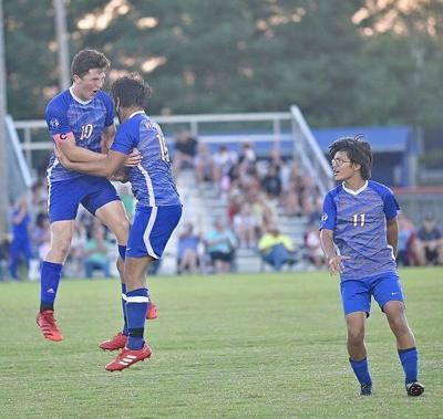 Warriors win county battle on late score