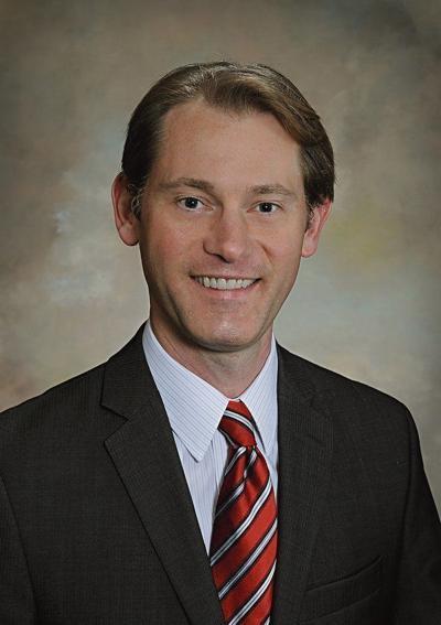 Adams lauds election reform bill