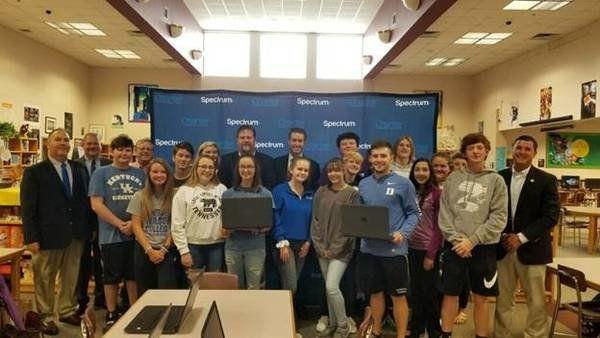 Spectrum donates laptop computers to local high schools