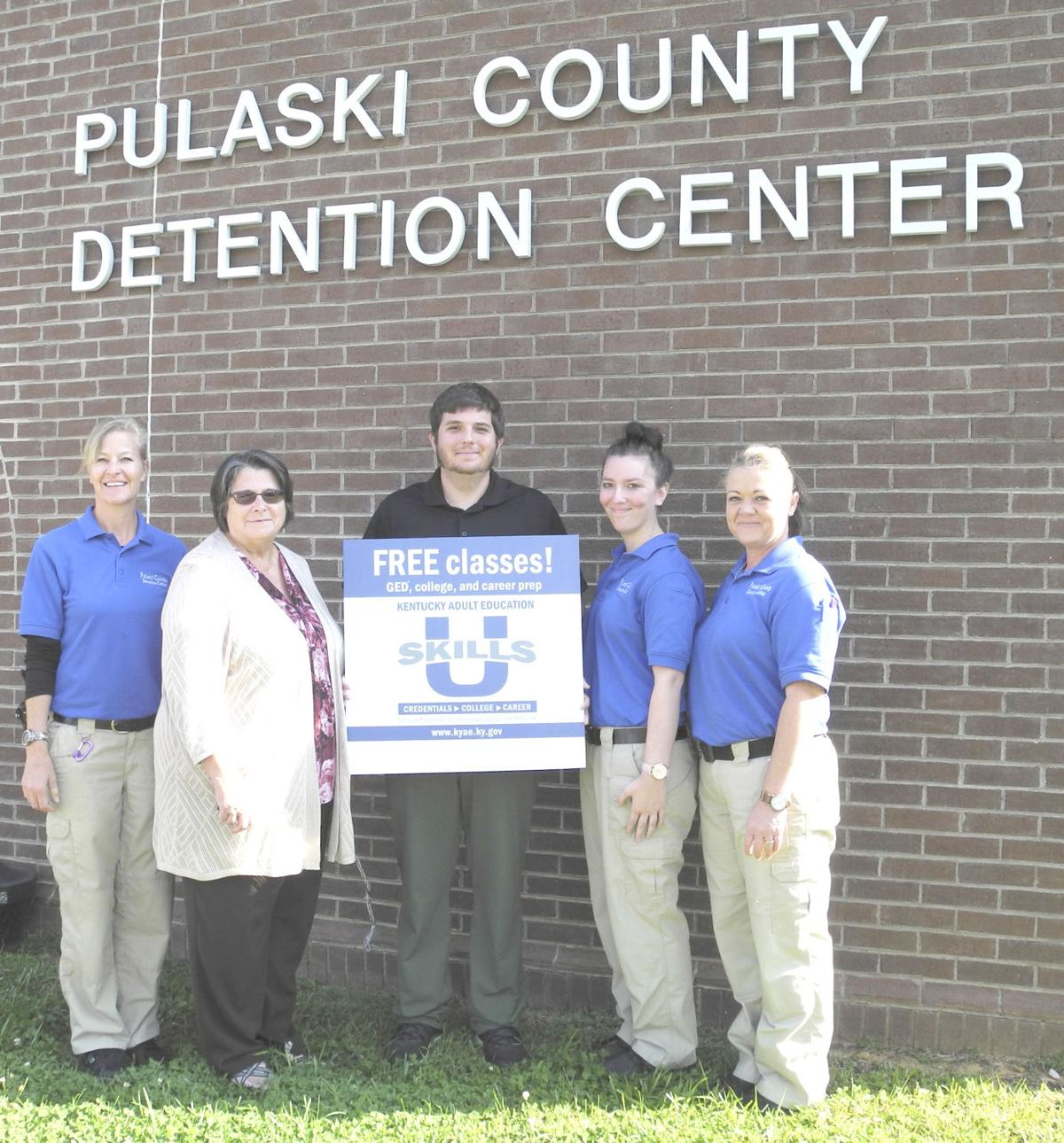 He is pictured with, from left, PCDC Programs Director Christy Fox, Pulaski Adult  Education Director Shirley Henderson, PCDC counselors ...