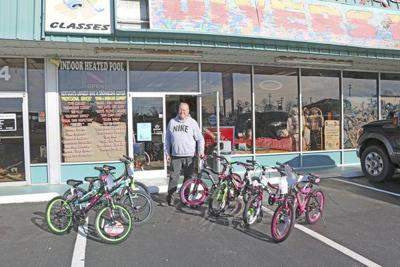 Local diving school owner plans bicycle giveaway for the summer