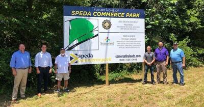 Officials unveil SPEDA Commerce Park sign