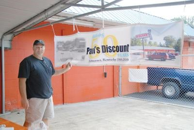 c1a4736e24 Joe Frank Neikirk, president and general manager of Paul's Discount, kept  busy Saturday afternoon as hundreds of patrons visited his store during its  50th ...