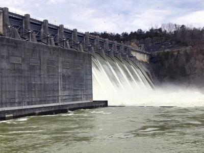 Water being released through dam being reduced