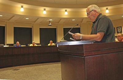 First reading held on zoning change despite lack of barrier wording