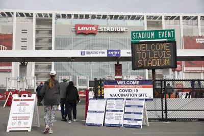Patients enter Levi's Stadium to receive Pfizer COVID-19 vaccines on Feb. 9 2021