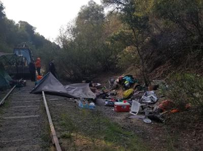 Homeless camps near railroad tracks cleared, cleaned-up