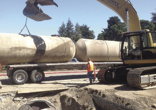 Crews Directed By The Certified Unified Program Agency Work To Pull  Underground Storage Tanks From The Miller Station Site, Located On The  Corner Of Main ...
