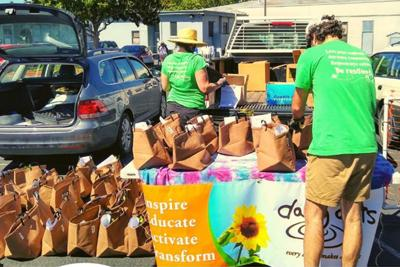 Daily Acts distributing garden kits.
